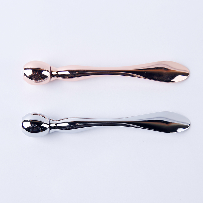 curved cosmetic spatula
