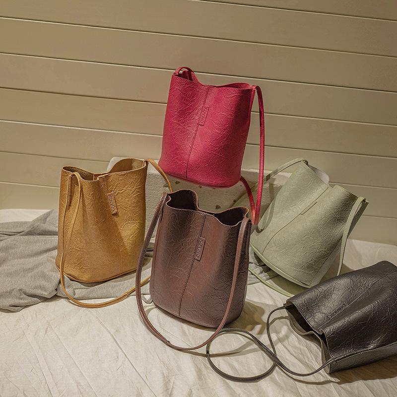 Fold inclined shoulder bag