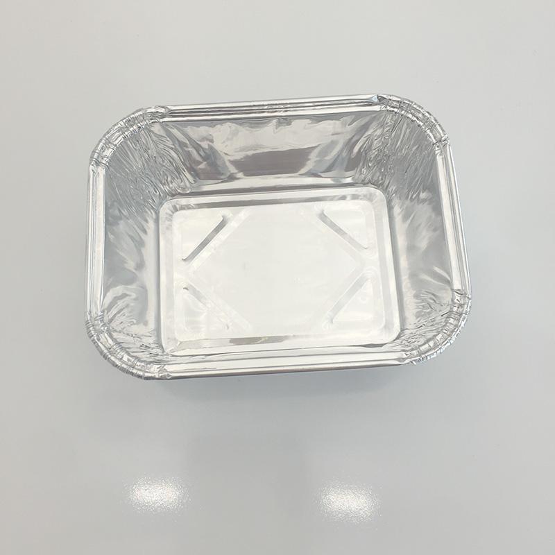 Aluminium foil tray in oven